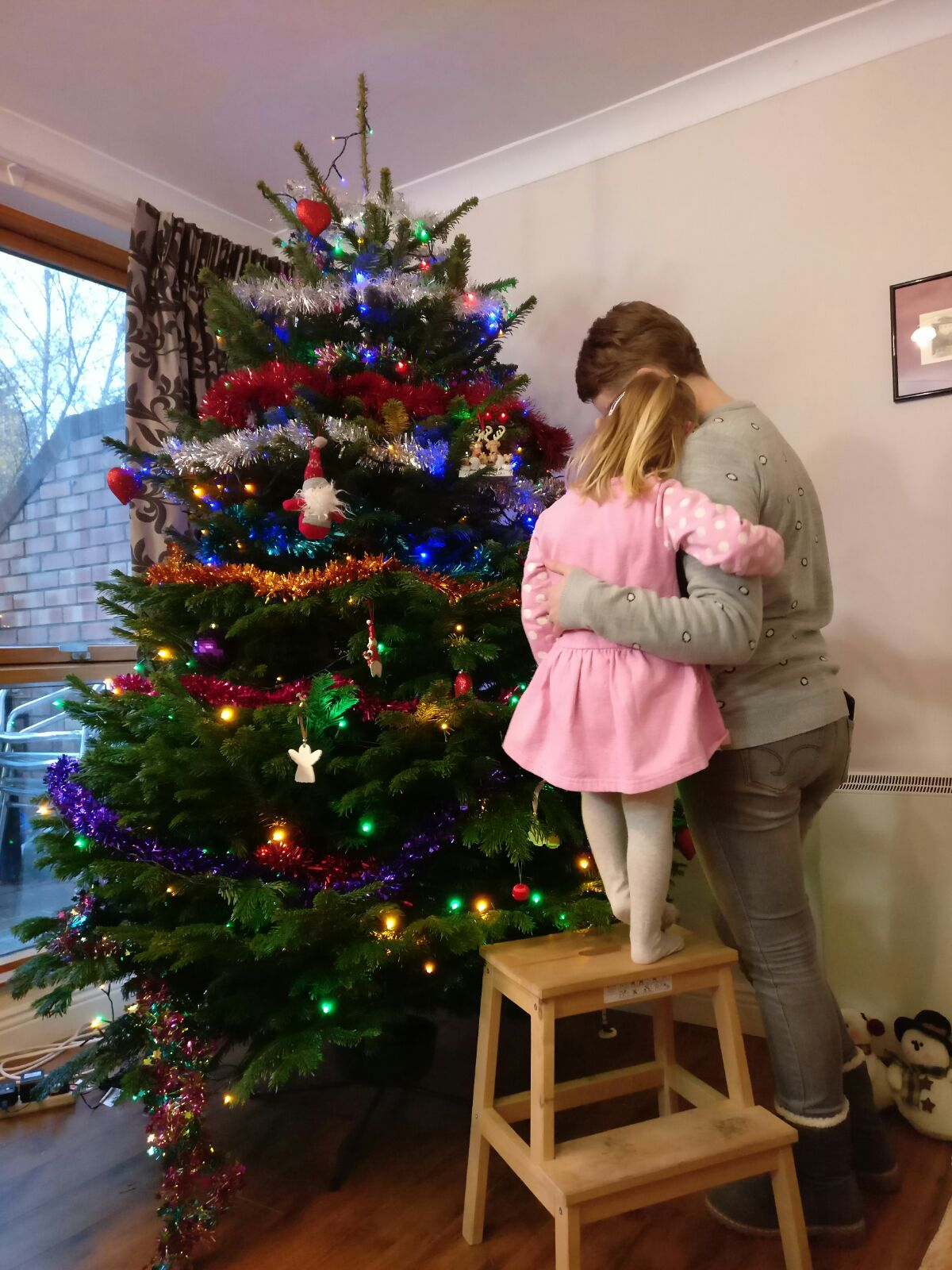 Scout & I hugging in front of Christmas tree, December 2016